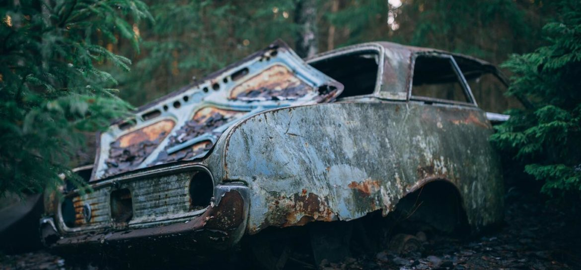 How Do Junk Cars Impact The Environment. Junk car in the woods.