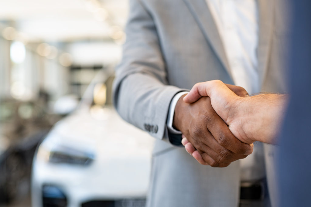 A handshake after they have learned how to spot a junk car scam.
