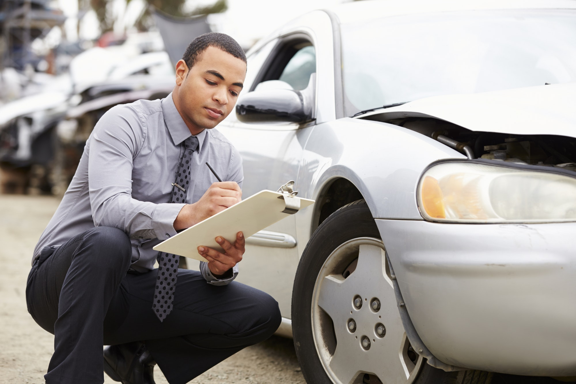 Get Your Salvage Certificate For Your Totaled Car. Car being inspected.