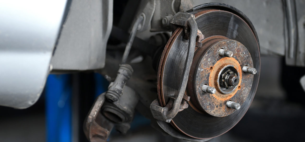 4 Signs Your Car Needs New Brakes. This image shows car brakes.