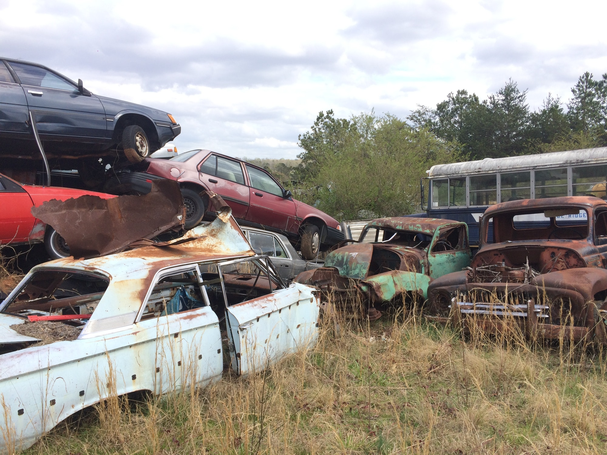 Be honest when trying to sell your junk card. A view of a junk yard.
